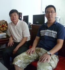 周扬波照片与美协副秘书长杜军合影